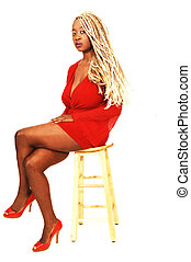 Sitting blond young woman - An blond girl in an short red...