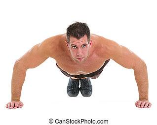Muscular man making push up exercises