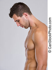 Profile portrait of strong muscular man