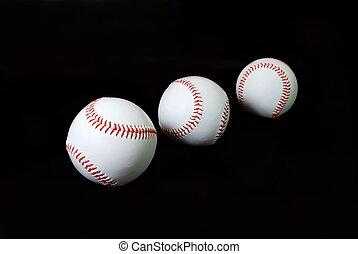 Baseballs on Black - Three baseballs isolated on black...