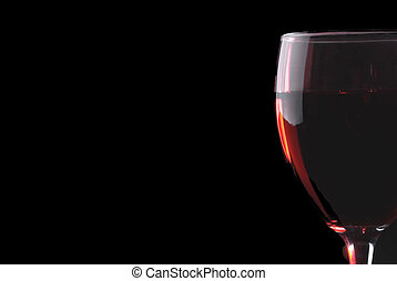 Low key red wine glass on a black background