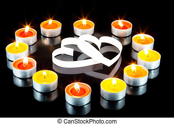 Two hearts, surrounded small candles - Two hearts,...