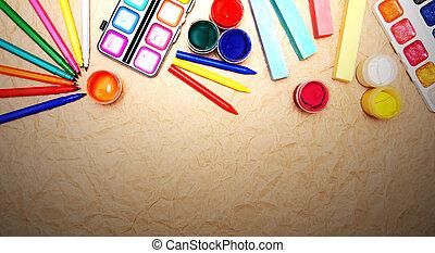School tools on rumpled paper.