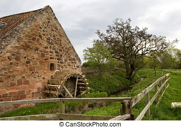 Old mill wheel - Picture of a waterwheel at an old mill in a...