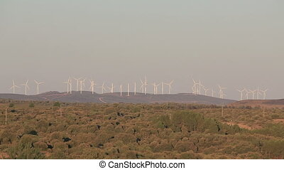 windmills - Far view of windmill farm in the mountains