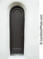 Narrow rustic door