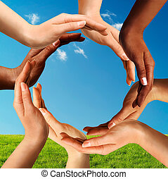 Multiracial Hands Making a Circle Together - Conceptual...