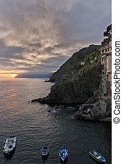 Sunset over the 13th Century village of Riomaggiore in Cinque Terre, Italy.