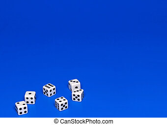 The dices on blue. - The dices on blue background.