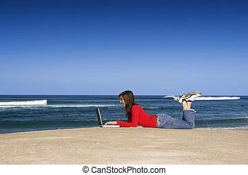 Outdoor work on laptop - Woman working with a laptop on the...