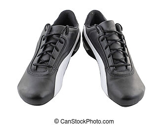Leather black sneakers on white. Isolated.