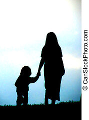 Silhouette-mother, child - A silhouette of a mother and her...