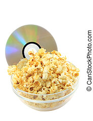 Bowl full of caramel popcorn with DVD disk . Isolated
