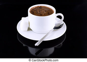 Cup of hot chocolate, sugar, on a black . - Cup of hot...