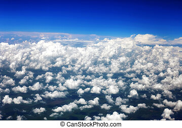 Beautiful view above the earth at the clouds below