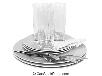 Pile of white plates, glasses, forks, spoons. - Pile of...