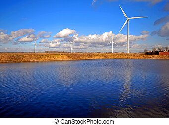 Wind Turbines and lake - Wind Turbines, lake and waste...