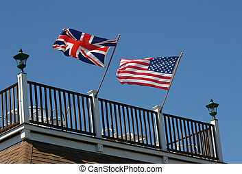 Two Flags - An American and British flag waving in the wind...