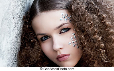 Lovely sensual woman face. Curly hairs. Beauty eyes