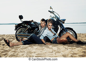 Young handsome boyfriend and girlfriend rider sitting...