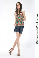 Young lovely slim woman in blouse and shorts - Beautiful...