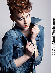 Unusual young glamorous woman in jeans jacket - bright make...