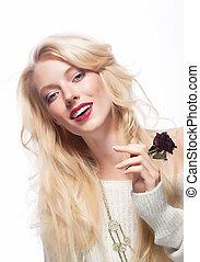Pretty female face. Blond long hair. Red flower - rose
