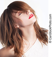 Attractive girl with closed eyes closeup portrait