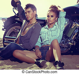 Travel destination. Young couple relaxing on beach - Two...