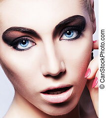 Woman face with beautiful bright makeup