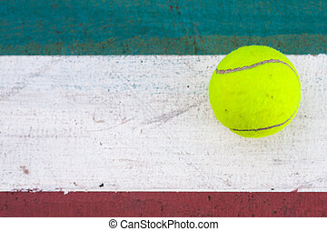 Tennis ball on the field Tennis ball resting on a golf ball...