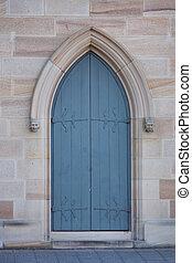 Blue wooden church door in arch