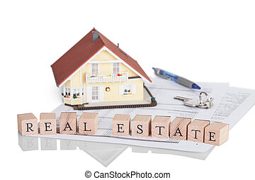 Mortgage concept with alphabet - Wooden blocks spelling the...
