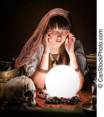 Fortuneteller with crystal ball - Diviner predicting the...