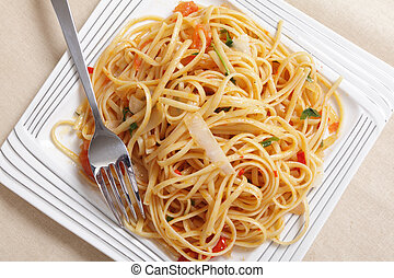 Linguine pasta tossed in a sauce of olive oil, tomato, garlic and basil and topped with slivers of parmasan cheese