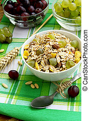 Breakfast with musli and grapes - bowl of healthy musli with...