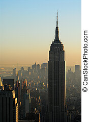 Aerial view over Manhattan at dusk, Empire State Building in...