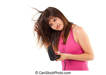 Beautiful smiling young woman drying her hair with hairdryer...