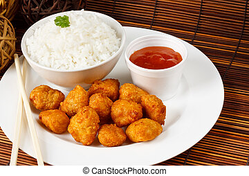 Sweet and sour battered pork balls with boiled rice