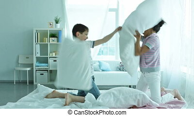 Pillow wrestling - Friends spending their free time actively...