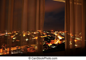 view on city  in a night from a hotel room