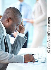 Businessman at work - Portrait of busy leader looking at...