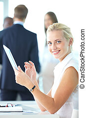 Woman with touchpad - Portrait of pretty businesswoman with...