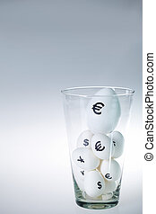 Eggs in glass - Image of white eggs with currency signs in...