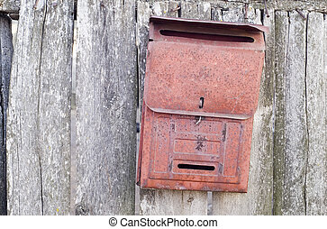 old mail box on the wooden door