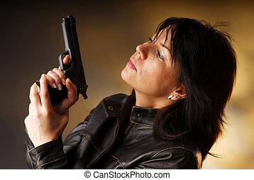 A killer - A woman with gun prepared to fire