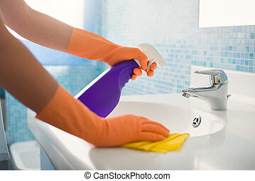 woman doing chores cleaning bathroom at home - woman doing...
