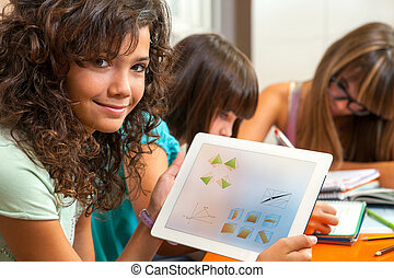 Cute girl showing homework on tablet - Close up portrait of...