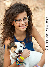 Young attractive girl with her dog - Close up portrait of...