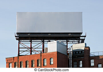 Empty Urban Billboard - A large blank urban billboard with...